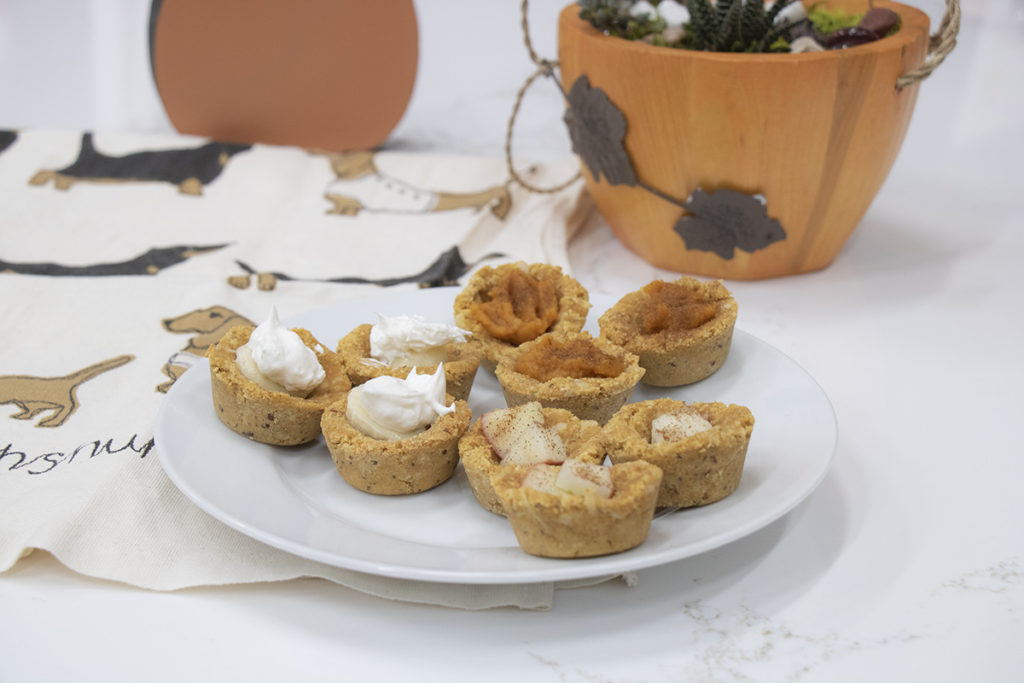 View of doggie pie cups with filling on plate